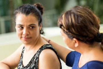 A woman being supported by a counsellor