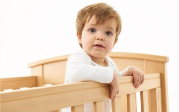 Boy in cot image