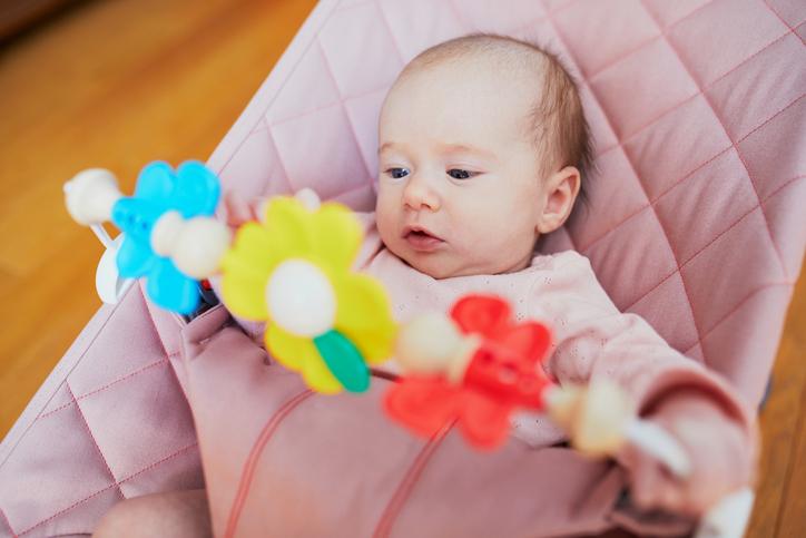 A baby in a rocker